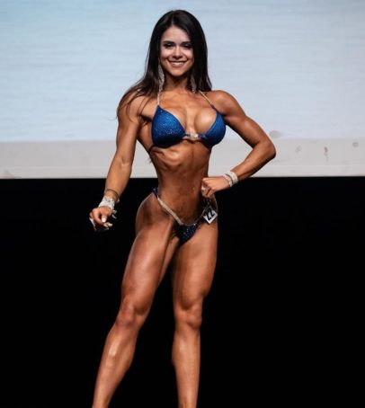 Beatriz Biscaia posing on the bikini stage looking fit and lean