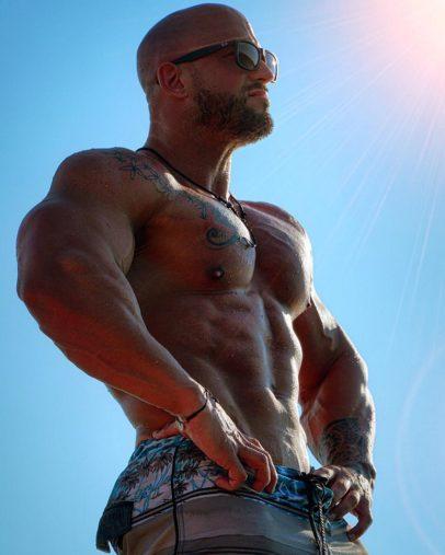 Benjamin Radic flexing shirtless in the sun