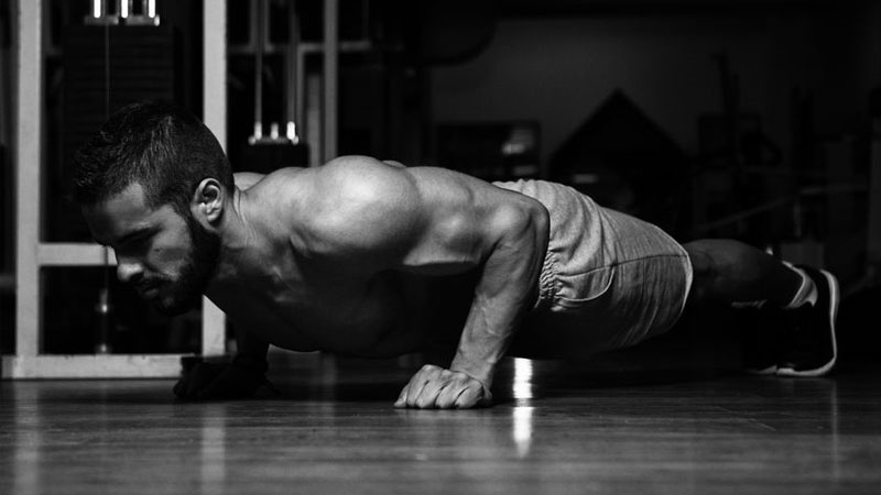 Bodybuilder performing press-ups