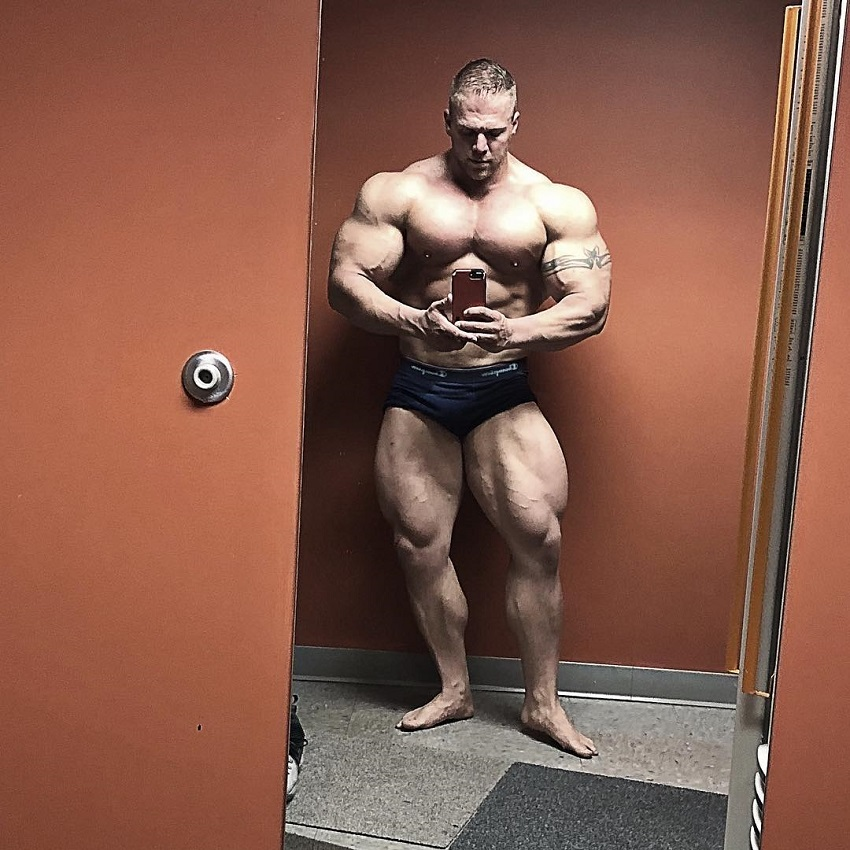 Brandon Beckrich taking a selfie of his ripped and huge body in the mirror