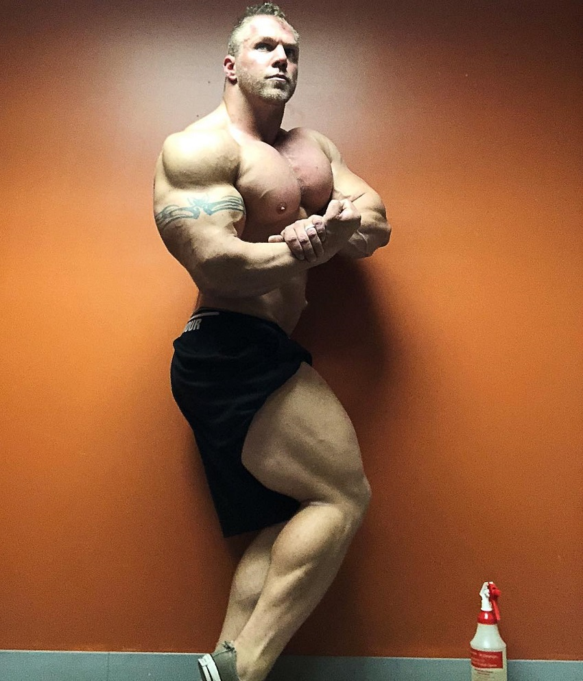 Brandon Beckrich performing a shirtless side chest bodybuilder's pose