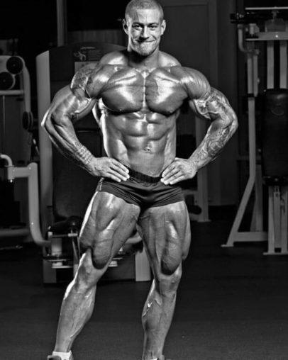 Caleb Blanchard posing shirtless in a gym