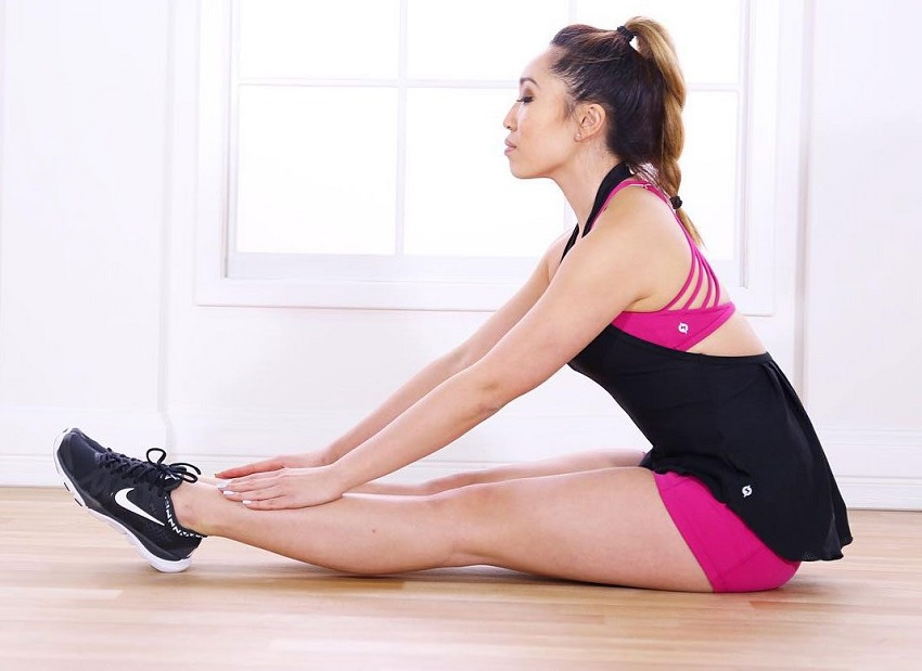 Cassey Ho stretching looking lean