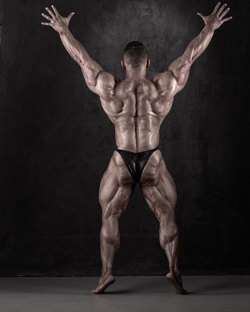 Hunter Labrada displaying his muscular and conditioned back in a bodybuilding photo shoot