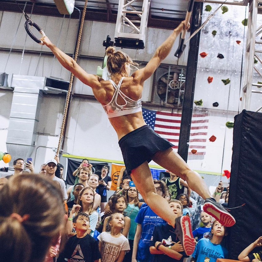 Jessie Graff performing ring stunts in front of a huge public