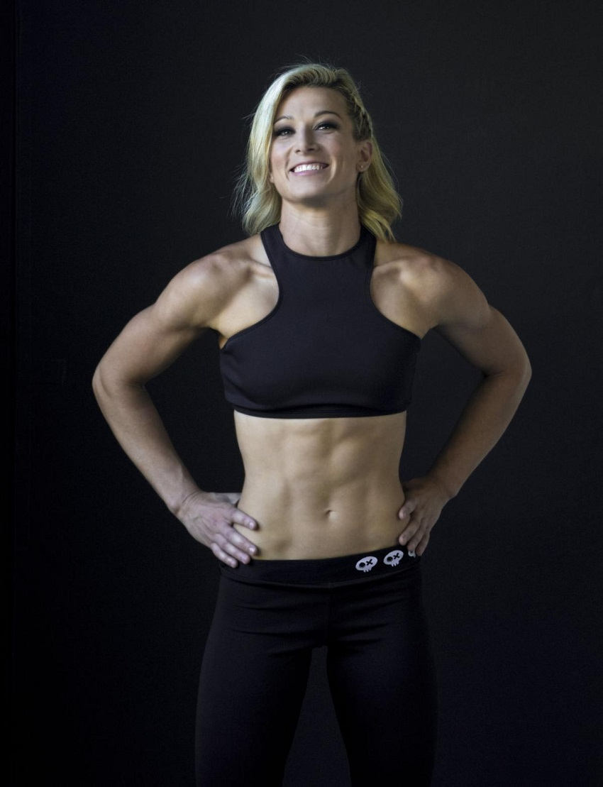 Jessie Graff smiling for the camera looking ripped