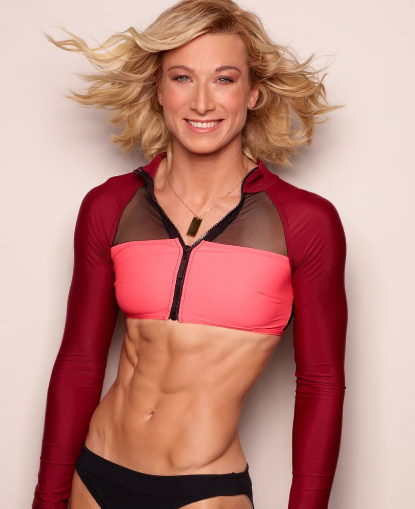 Jessie Graff posing for a picture smiling and looking fit