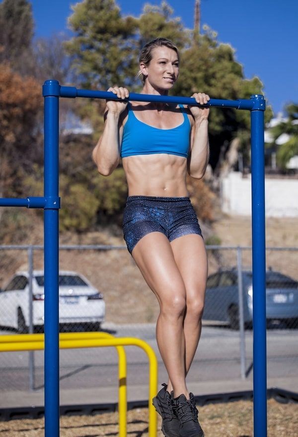 Jessie Graff doing pull ups outdoors