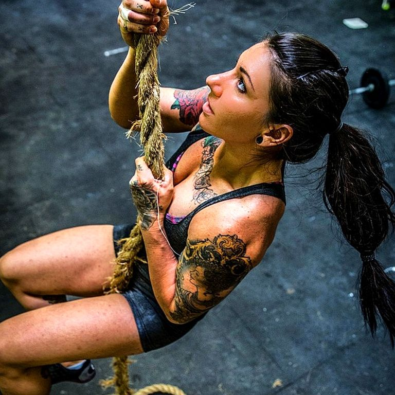 Kat Leone climbing a rope during CrossFit training