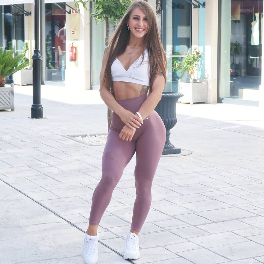 Olena Starodubets posing outdoors looking fit