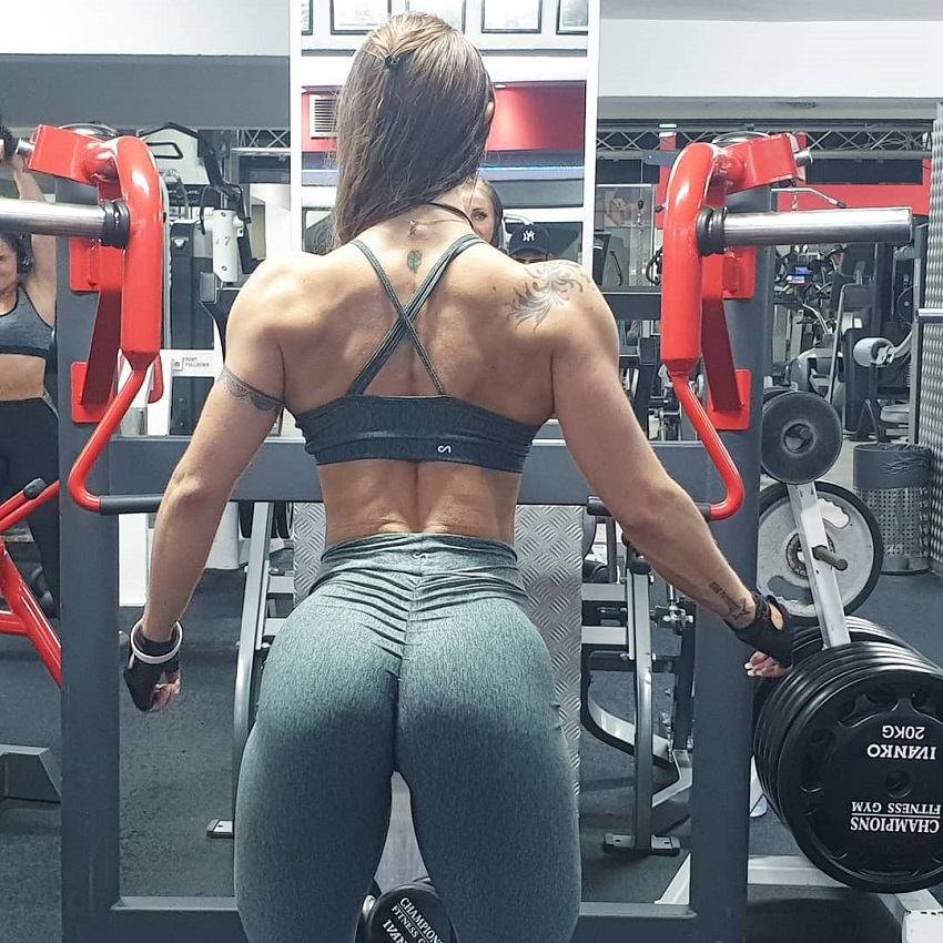 Olena Starodubets spreading her lats wide in the gym