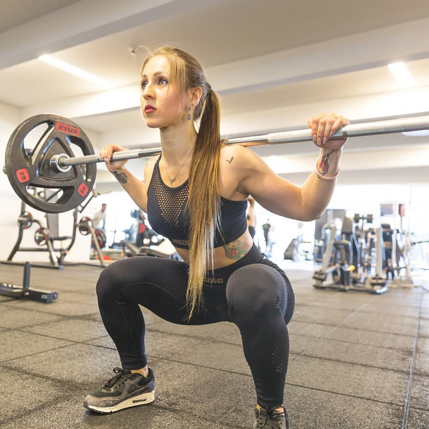 Olena Starodubets doing squats in a gym