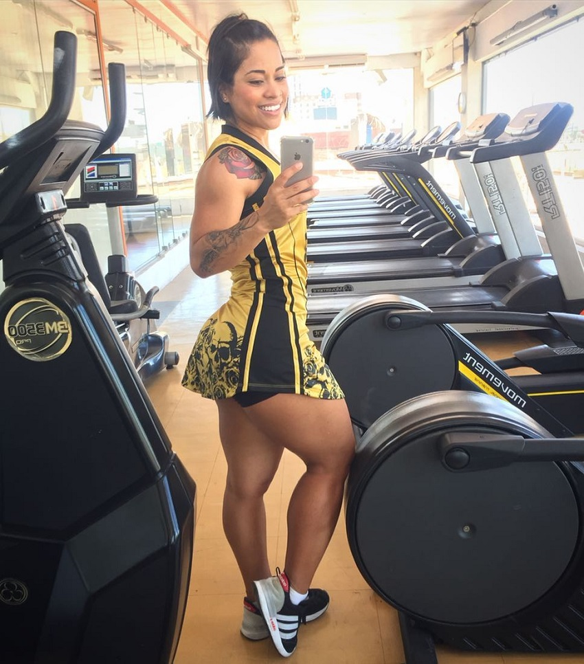 Rosana Ollyver taking a picture of herself near cardio machines