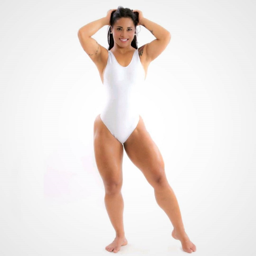 Rosana Ollyver posing in white sportsuit during a photo shot