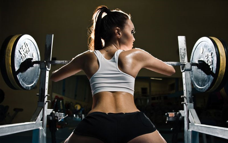 Woman in squat rack