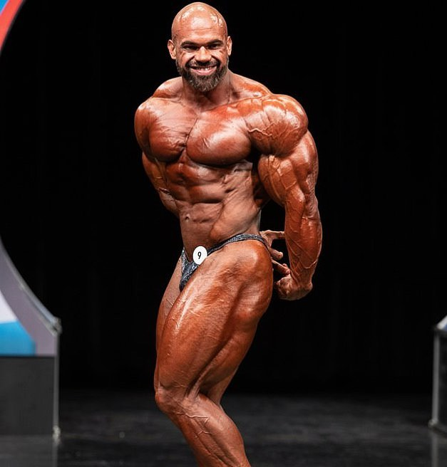 Alexis Rivera Rolon doing a side triceps pose on a bodybuilding stage, looking confident and impressive