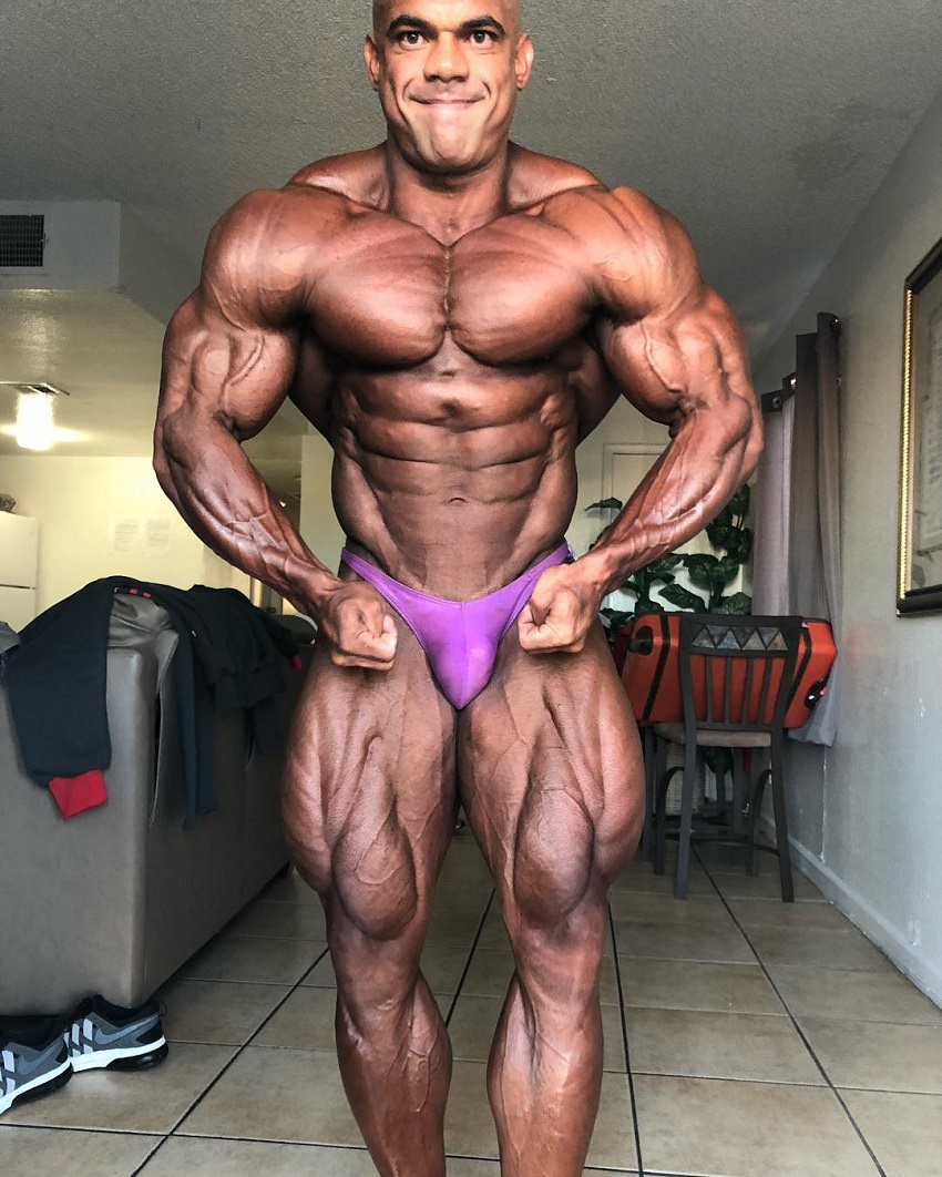 Alexis Rivera Rolon posing shirtless, tanned up, looking huge and ripped, ready for a show