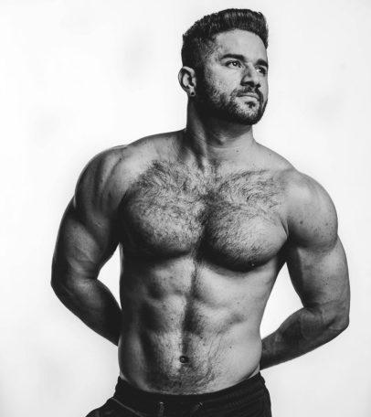 Bremen Menelli posing shirtless in a photo shoot