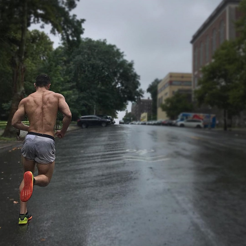 Bremen Menelli running shirtless down the street
