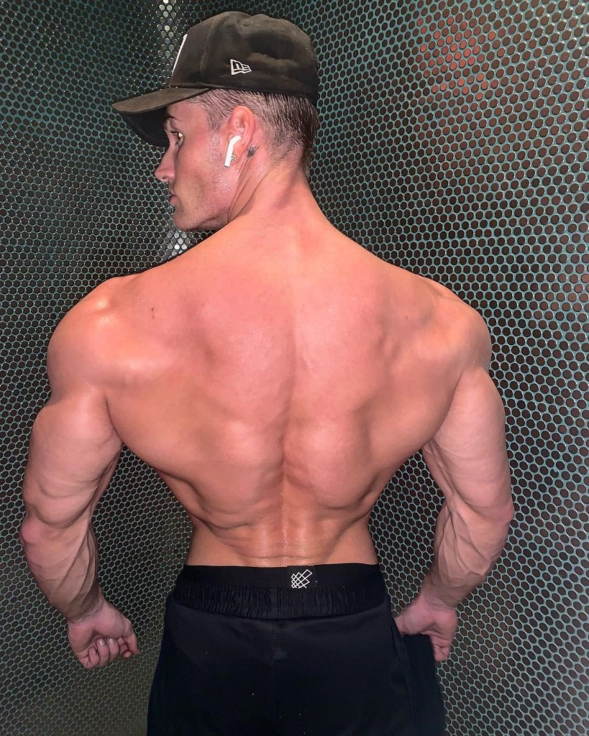 Carlton Loth showing off his wide and huge back for the camera