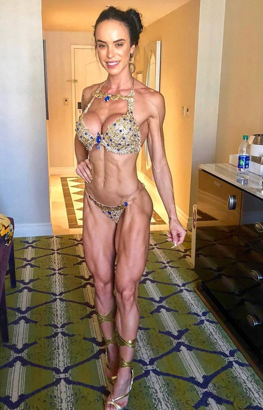 Catia Isabel standing in a bikini in a hotel room looking fit and lean