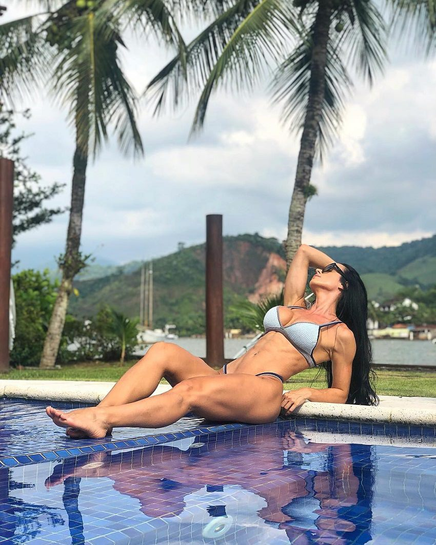 Catia Isabel posing by the pool looking fit and lean