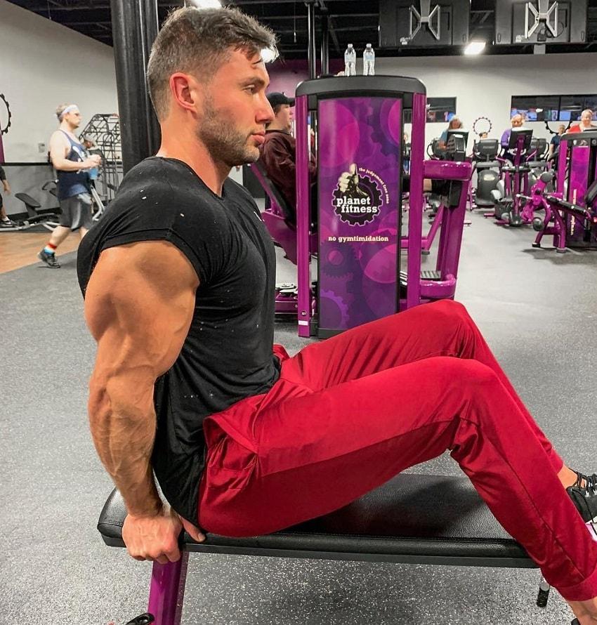 Daniel Zukich doing triceps bench dips, his arm looking huge