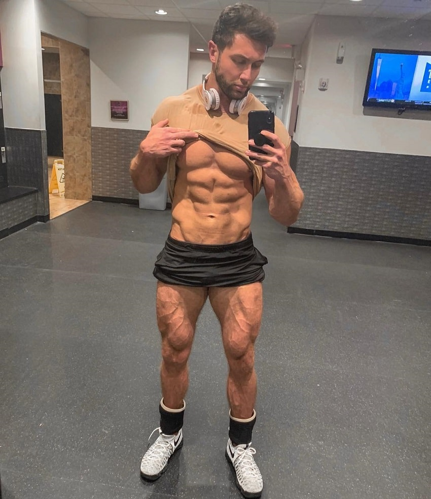 Daniel Zukich taking a selfie of his ripped abs and vascular legs