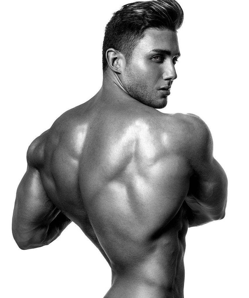 Daniel Zukich posing shirtless in a professional modeling photo shoot, showing off his wide and aesthetic back muscles