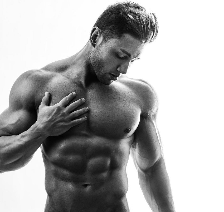 Daniel Zukich posing shirtless in a professional photo shoot looking ripped