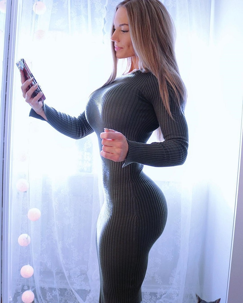 Elin Hedstrom posing in a tight dress looking curvy
