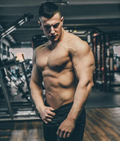 Francesco Della Vedova posing shirtless in the gym
