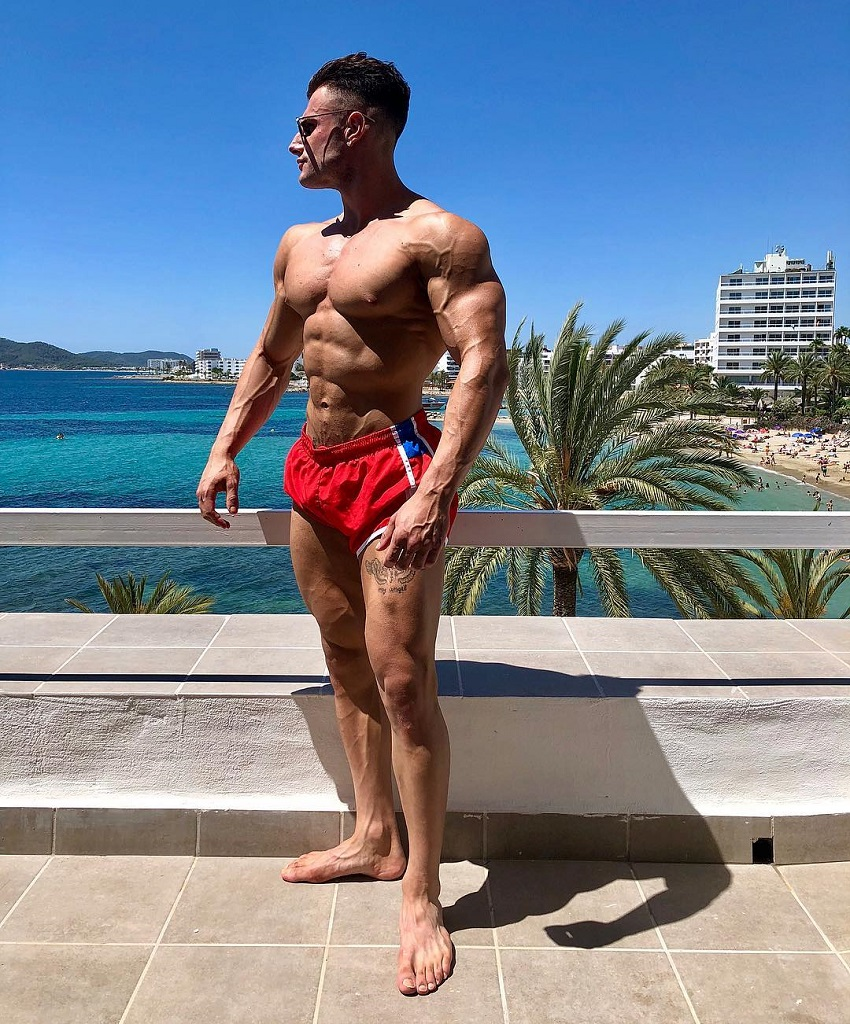 Francesco Della Vedova posing shirtless outdoors looking ripped and swole