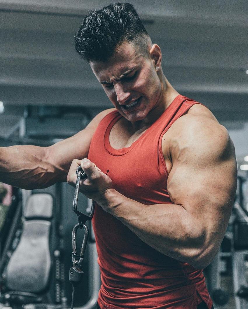 Francesco Della Vedova doing intense cable biceps curls