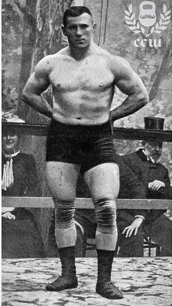 George Hackenschmidt posing shirtless in front of a crowd
