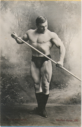 George Hackenschmidt standing shirtless and posing for a picture, looking muscular