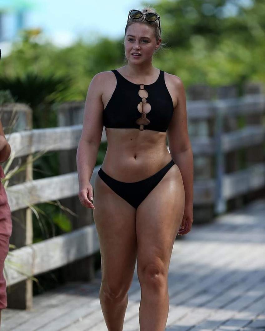 Iskra Lawrence walking down the wooden bridge, looking curvy