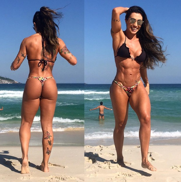 Jaque Khury posing on the beach, her abs and glutes looking amazingly curvy and fit