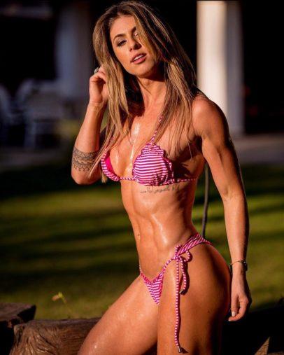 Juliana Martin posing in a bikini, showing off her amazing and lean figure