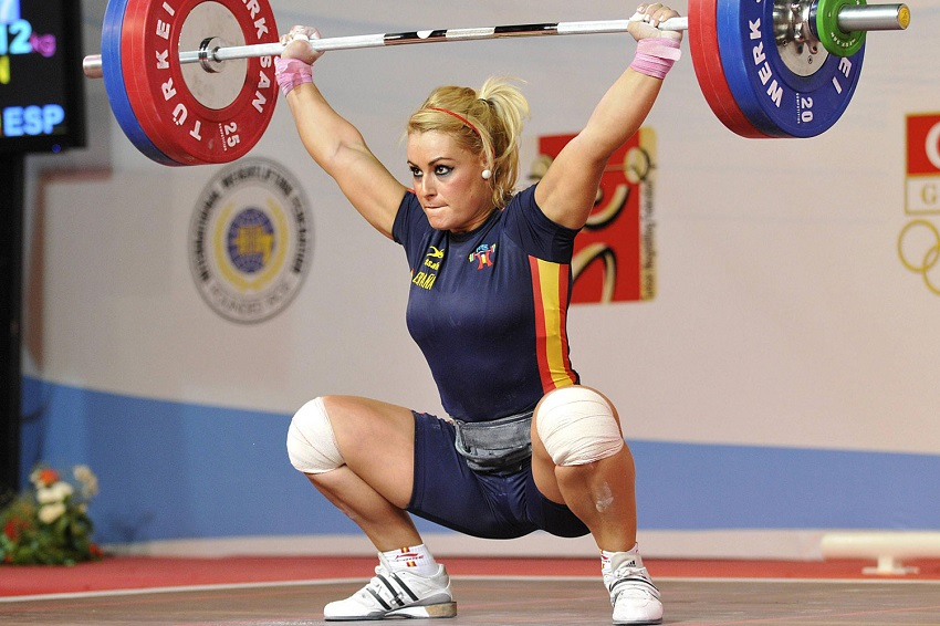 Lidia Valentin Perez performing a snatch in the weightlifting competition