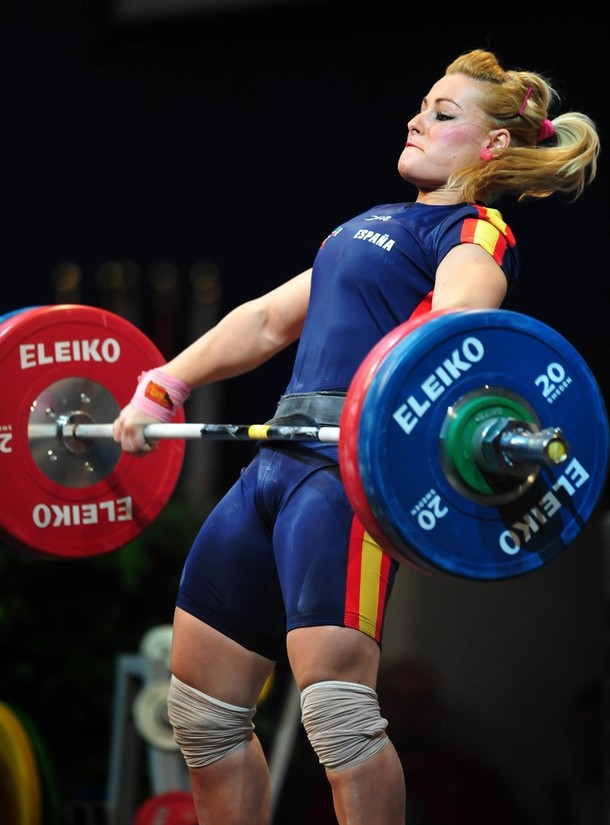 Lidia Valentin Perez performing an extremely intense barbell exercise during a weightlifting competition