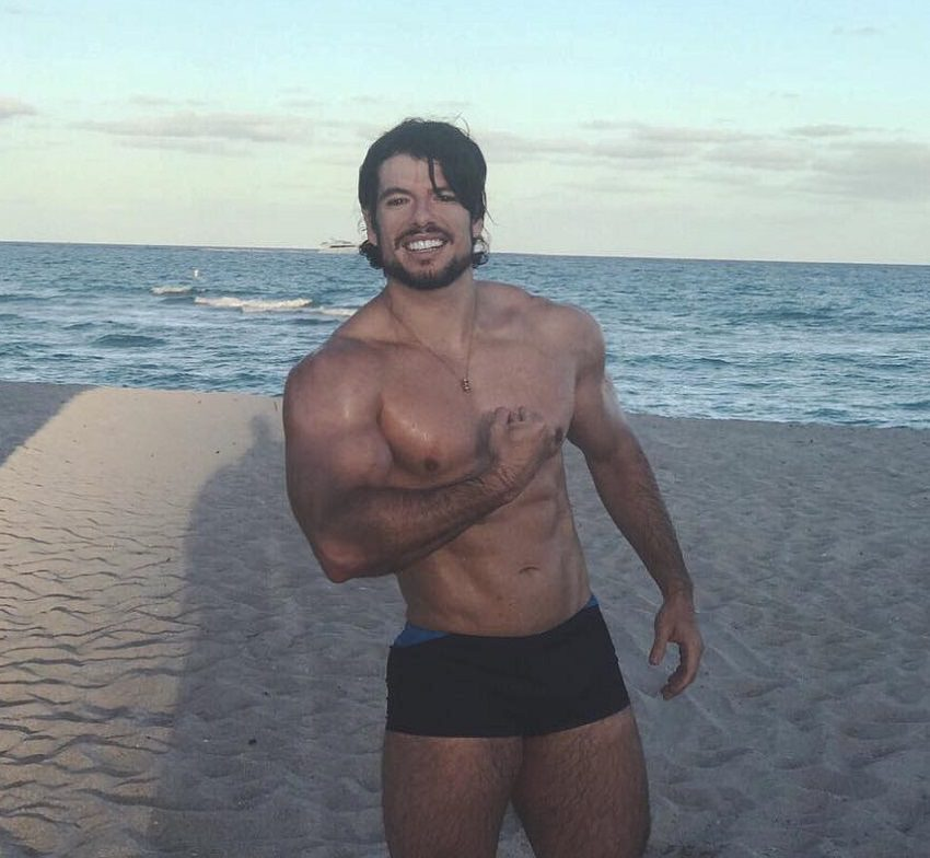 Lucas Giovani flexing on the beach looking fit and lean