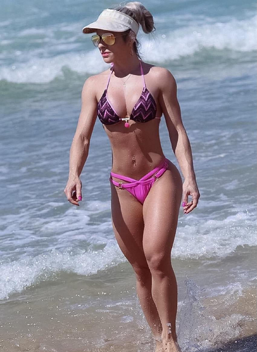 Mari Carvalho walking down the beach looking fit and toned