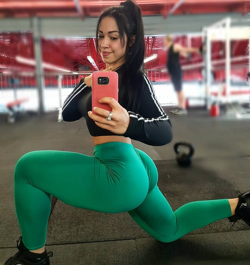 Megane Di Ioia taking a picture of her curvy glutes in green leggings