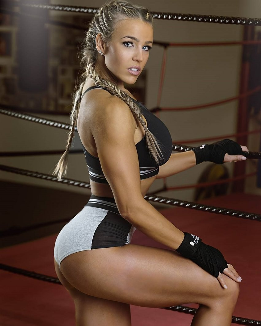 Michelle Bieri posing in a boxing ring looking fit and healthy