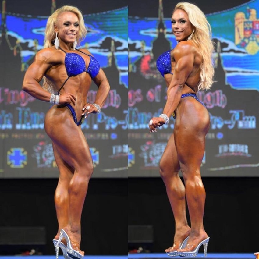 Minna Pajulahti posing on the bodybuilding stage looking toned and aesthetic