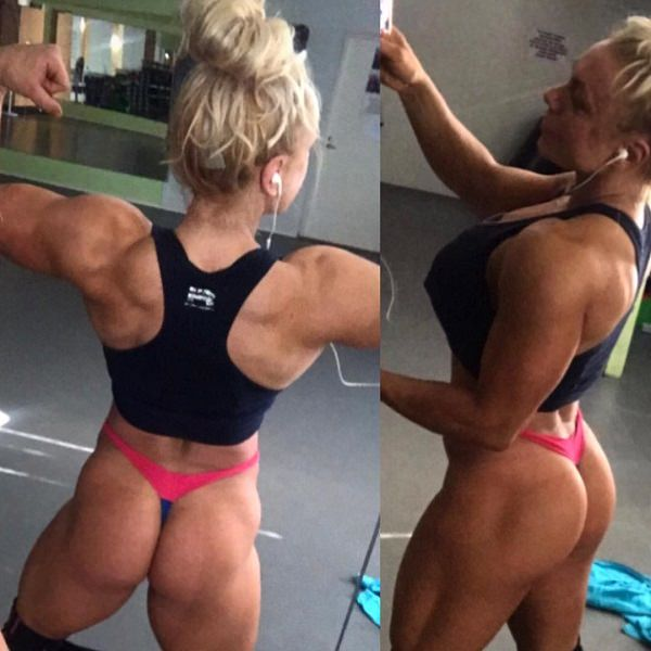 Minna Pajulahti flexing her muscles looking lean and toned