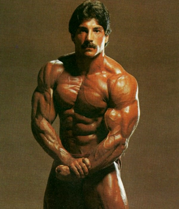 Ray Mentzer flexing his shirtless and ripped body for the photo shoot