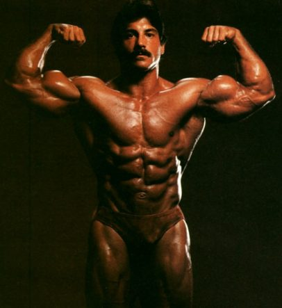 Ray Mentzer flexing his biceps for the photo