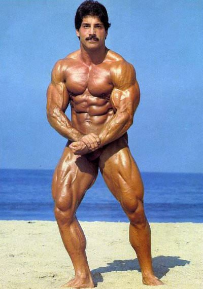 Ray Mentzer performing the most muscular pose on the beach